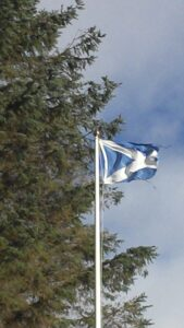 Windy day with Scottish Saltire Flag blowing in the wind